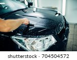 specialist prepares car for... | Shutterstock . vector #704504572