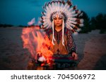 american indian girl against... | Shutterstock . vector #704506972
