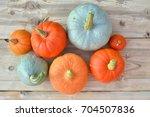 orange and blue pumpkins on... | Shutterstock . vector #704507836