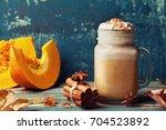 warm pumpkin spiced latte or... | Shutterstock . vector #704523892