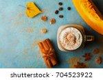 pumpkin spiced latte or coffee... | Shutterstock . vector #704523922