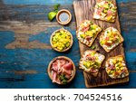toasts with cream cheese  ham... | Shutterstock . vector #704524516
