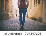 tourist woman walks on the... | Shutterstock . vector #704547205