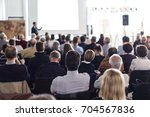speaker giving a talk in... | Shutterstock . vector #704567836