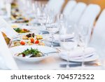 beautifully served table in a... | Shutterstock . vector #704572522