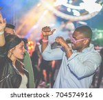 young friends dancing at party... | Shutterstock . vector #704574916
