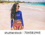 beach rashguard bikini woman...   Shutterstock . vector #704581945