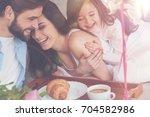 Cheerful vibrant family enjoying happy moments