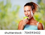 smiling young woman with braces ... | Shutterstock . vector #704593432
