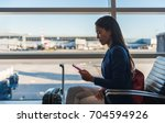 airport phone travel woman... | Shutterstock . vector #704594926