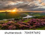 evening sun bursting through... | Shutterstock . vector #704597692