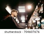 man is doing a haircut. men's... | Shutterstock . vector #704607676