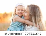 lifestyle portrait of mom and... | Shutterstock . vector #704611642