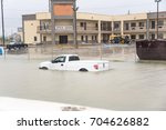 pickup truck swamped by flood... | Shutterstock . vector #704626882