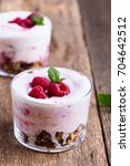 Small photo of Raspberry trifle with crunchy toasted oats and dried fruit, eton mess style granola dessert