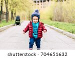 baby laughing running  with... | Shutterstock . vector #704651632