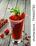 glass of fruit cocktail drink... | Shutterstock . vector #704663782