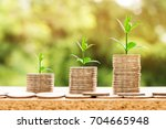step of coins stacks with tree... | Shutterstock . vector #704665948