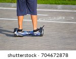 the boy is riding an old... | Shutterstock . vector #704672878