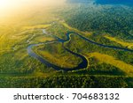 aerial view of a rainforest in... | Shutterstock . vector #704683132