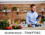 man man looking for a recipe... | Shutterstock . vector #704697082