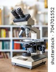 microscope with education...   Shutterstock . vector #704701552