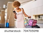 african american woman checking ... | Shutterstock . vector #704705098