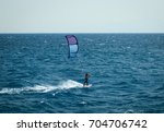 kiteboarding sportsman rider... | Shutterstock . vector #704706742