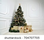 decorated gold christmas tree... | Shutterstock . vector #704707705