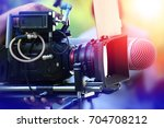 Small photo of VDO grapher working with professional equipment in movie production.