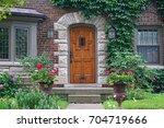 Wooden Front Door Of House Wit...