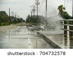 Water Coming Over The Road In...