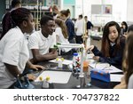 group of students laboratory... | Shutterstock . vector #704737822