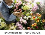florist making fresh flowers... | Shutterstock . vector #704740726