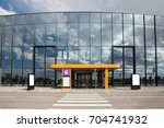 entrance to the new modern... | Shutterstock . vector #704741932
