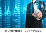 investment concept hand with... | Shutterstock . vector #704744392