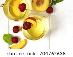 peach wine and fruits on white... | Shutterstock . vector #704762638