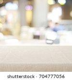 empty tabletop with linen... | Shutterstock . vector #704777056