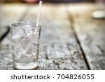 water ice in glass on wood... | Shutterstock . vector #704826055