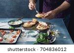 man cooking bruschetta with... | Shutterstock . vector #704836012
