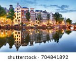 amsterdam at night   holland ... | Shutterstock . vector #704841892