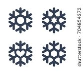 snowflakes signs set. black... | Shutterstock .eps vector #704854372