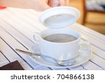 delicious mushroom soup in a... | Shutterstock . vector #704866138