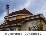 house roof against the sky | Shutterstock . vector #704888962