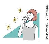 a woman drinking a drink | Shutterstock .eps vector #704904802