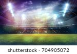 stadium in lights and flashes... | Shutterstock . vector #704905072