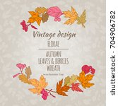 wreath of autumn leaves and...   Shutterstock .eps vector #704906782