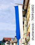 typical bavarian flag in front... | Shutterstock . vector #704916802