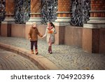 beautiful girl and boy hold... | Shutterstock . vector #704920396
