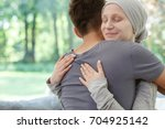 sick wife hugging husband after ... | Shutterstock . vector #704925142